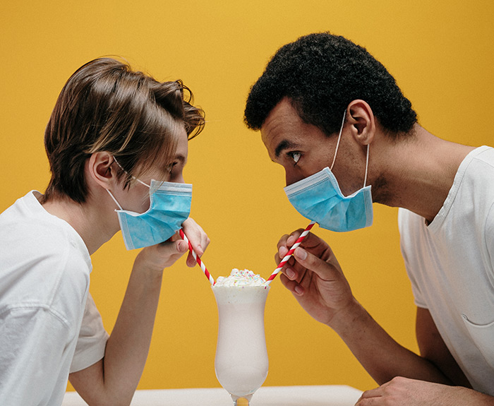 man-and-woman-drinking-milkshake-3951878